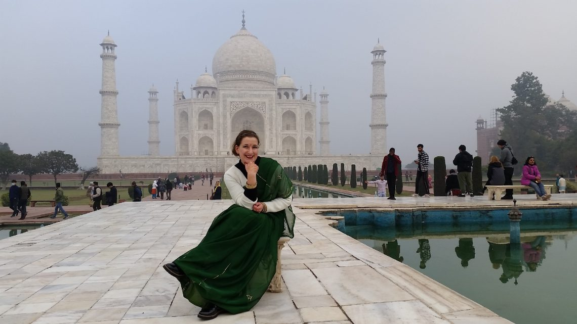 Taj Mahal visit with the fountain as a central piece sari India tourist