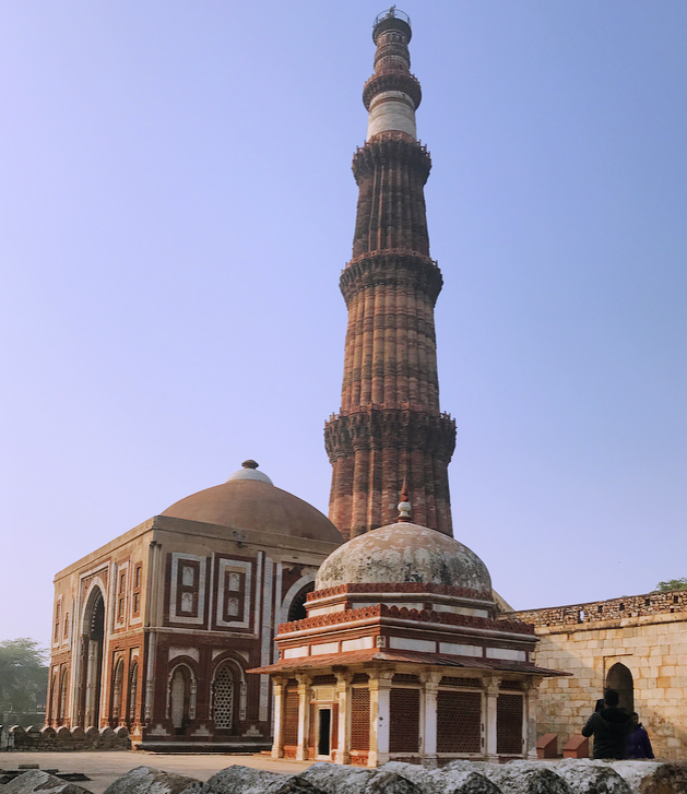 The Qutub minar in the background and some of the mauselums present at the ancient complex