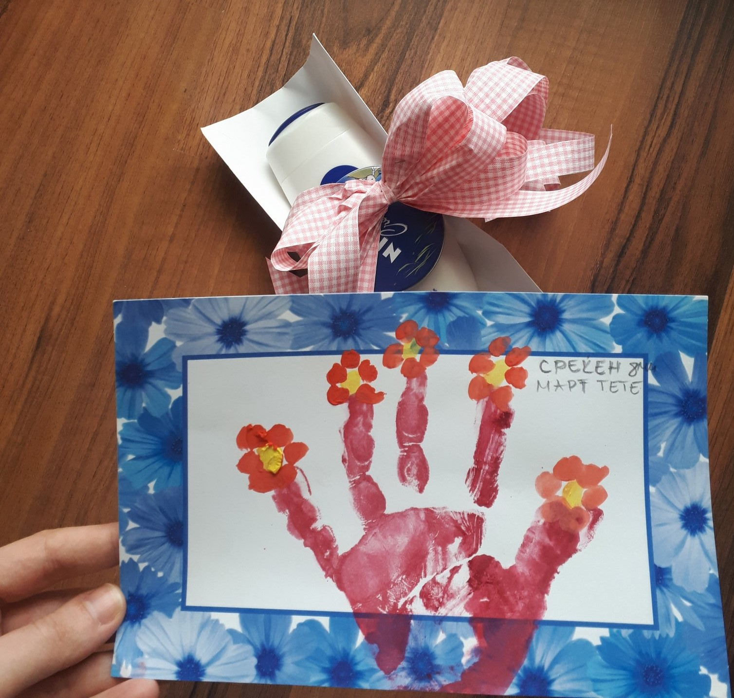 beautiful card with flowers and hand as a gift for an aunt for 8th of march