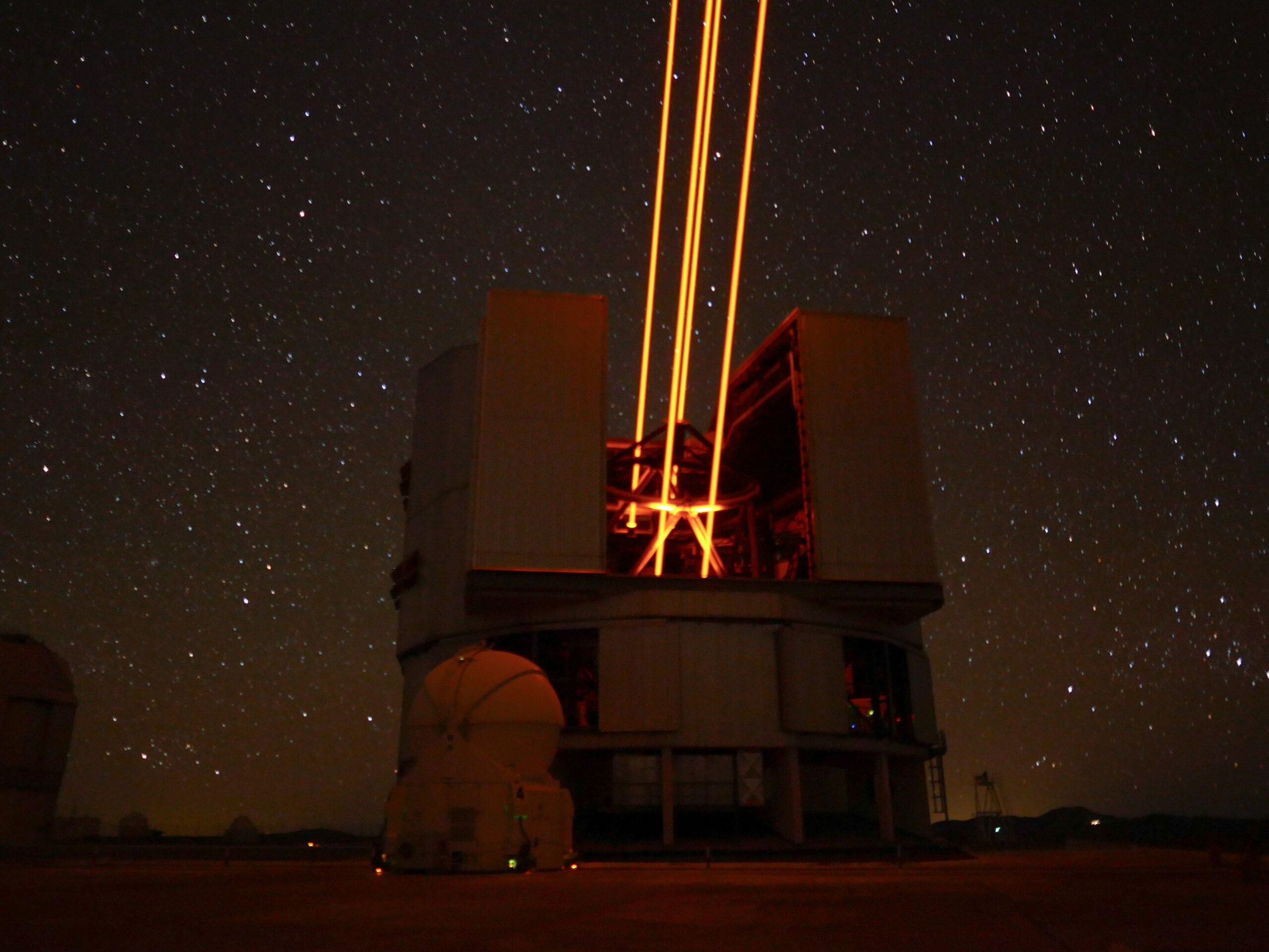 adaptive optics instrument at the Paranal observatory in Chile. Creating four artificial start with lasers. Phto credits: Dr. Johanna Hartke, a post-doctoral fellow at ESO.